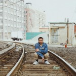 Jordan Martins on Railroad Tracks by Dondre Green